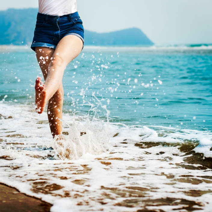 Happy girl in a calm beach.